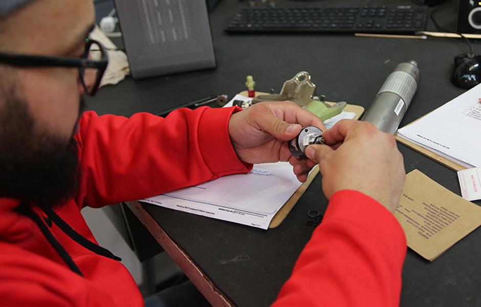 Technician Working on Part